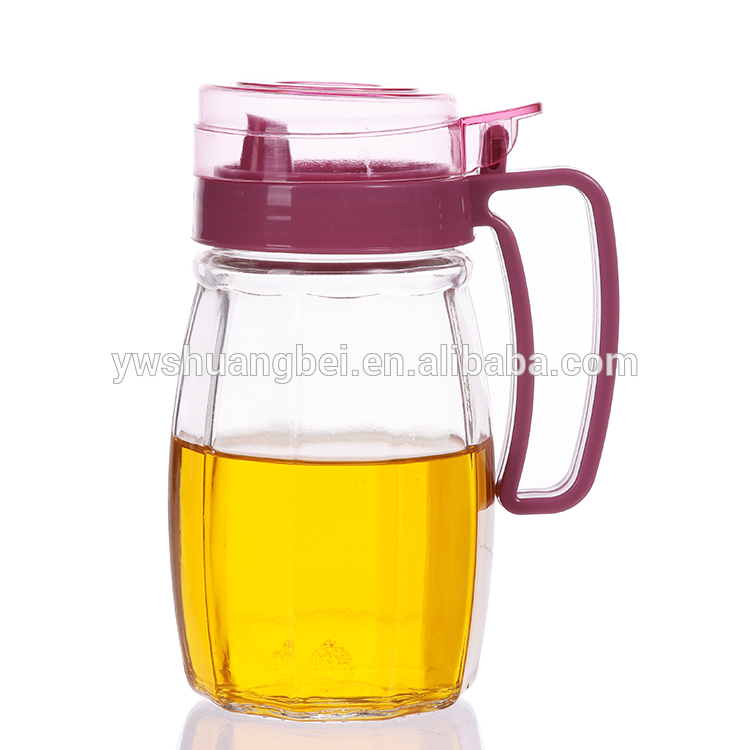Wholesale high quality and transparent glass oil pitcher with red cap and handle